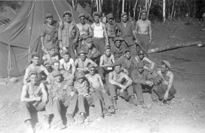 "A section from ""C"" Battery take a break from camp construction on New Guinea"